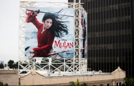 "An outdoor ad for Disney's ""Mulan"" is seen on March 13, 2020 in Hollywood, California. The spread of COVID-19 has negatively affected a wide range of industries all across the global economy. PHOTO: AFP"