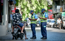 Maldives Police Service (MPS) seen enforcing the Health Protection Agency imposed curfew restricting movement across greater Male' region between 1700 to 2000 hrs. PHOTO: MIHAARU