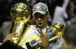 (FILES) In this file photo taken on June 14, 2009, Kobe Bryant of the Los Angeles Lakers celebrates victory following Game 5 of the NBA Finals against the Orlando Magic at Amway Arena in Orlando, Florida. - Five-time NBA champion Kobe Bryant headed a star-studded list of honorees named to basketball's 2020 Hall of Fame on April 4, 2020. The Los Angeles Lakers icon, who died in a helicopter crash in January, was named alongside nine honorees who will be enshrined at the Naismith Memorial Basketball Hall of Fame on August 29. (Photo by Emmanuel DUNAND / AFP)