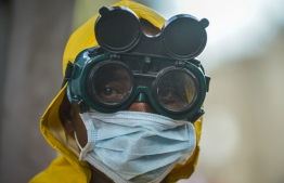 A cleaning staff wears protective gear to disinfect a metro carriage as a preventive measure against the spreading of the COVID-19 coronavirus in Addis Ababa, Ethiopia, on March 20, 2020. - African countries have been among the last to be hit by the global COVID-19 coronavirus epidemic but as cases rise, many nations are now taking strict measures to block the deadly illness. PHOTO: MICHAEL TEWELDE / AFP