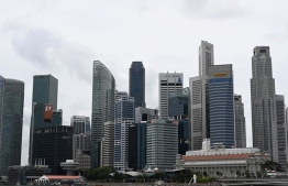 Singapore has now ordered the closure of all businesses deemed non-essential. PHOTO: AFP