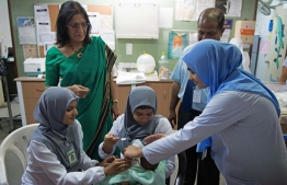 Regional Director for WHO South East Asia Dr Poonam Khetrapal Singh with nurses of Indira Gandhi Memorial Hospital. PHOTO/WHO MALDIVES