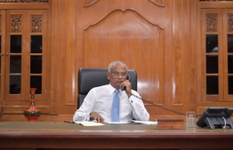 President Ibrahim Mohamed Solih pictured on a telephone call. PHOTO/PRESIDENT'S OFFICE