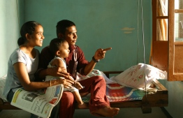 Family on a swing. PHOTO: PIROZZI/ UNICEF