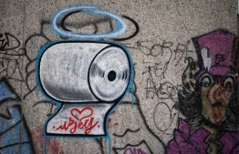 A graffiti by artist Kai 'Uzey' Wohlgemuth representing a toilet paper roll ist pictured on a wall in Hamm, western Germany, on April 8, 2020 refering to the spread of the novel coronavirus COVID-19. (Photo by Ina FASSBENDER / AFP)