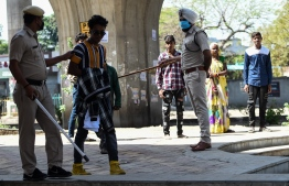 India's billion-plus population went into a three-week lockdown on March 25. On Tuesday, Prime Minister Narendra Modi has made the decision to extended the lockdown until at least May 3. PHOTO: AFP