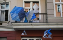 """An art installation, part of the """"Balconies, Life, Art, Pandemic, and Proximity"""" exhibition is seen in Berlin on April 12, 2020, amid a new coronavirus COVID-19 pandemic. - Over 30 artists are taking part in the two-day exhibition which calls on """"the artistic community living in [Berlin's district of] Prenzlauer Berg to activate / exhibit / inhabit / their windows and balconies on Easter Sunday and Monday"""". Curated by Ovul Durmusoglu and Joanna Warsza, the exhibition boasts """"zero budget, no openings, no crowds, just a proposition of a stroll that would connect dots in solidarity and togetherness"""". (Photo by John MACDOUGALL / AFP)"""