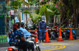 Police officer near an area closed off in Male. PHOTO: AHMED ASHWAN ILYAS / MIHAARU
