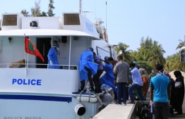 Maldivians being transported for mandatory quarantine after returning from abroad. PHOTO: POLICE
