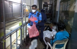 Police Officers distribute food and other essential supplies to people that have been rendered homeless or find themselves stranded in Male due to the local travel bans. PHOTO: POLICE MEDIA