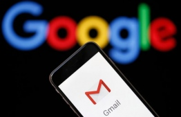In this photo illustration, the logo of the Gmail app homepage is seen on the screen of an iPhone in front of a computer screen showing a Google logo.  PHOTO: CHESNOT/ GETTY IMAGES