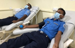 Police Officers, during a break between deliveries and patrols, find time to donate blood for Thalassemia patients in serious need of transfusions and for blood bank to use in emergency situations. PHOTO: MIHAARU