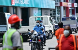 Police officers patrol the streets of capital city Male' during lockdown. PHOTO: AHMED AWSHAN ILYAS / MIHAARU
