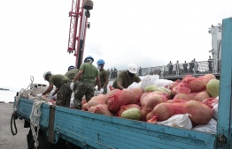 MNDF officers work to unload good items sent to the Maldives, for distribution across the country. PHOTO: MNDF