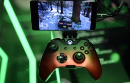 (FILES) In this file photo taken on August 21, 2019 a cloud-based console is displayed at the Microsoft Xbox stand during the Video games trade fair Gamescom in Cologne, western Germany. (Photo by Ina FASSBENDER / AFP)