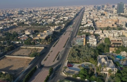 An aerial view shows deserted streets in the Saudi coastal city of Jeddah on April 21, 2020, during the novel coronavirus pandemic crisis. (Photo by BANDAR ALDANDANI / AFP)