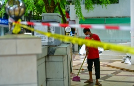 An expatriate worker cleaning the now closed down mosques. As a result of the ongoing COVID-19 outbreak in the country, Maldives has temporarily halted all public prayers. PHOTO: AHMED AWSHAN ILYAS / MIHAARU