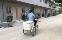 A resort worker, from the housekeeping division, cycles his way to work from the 'back of the house' area to where the guests mingle and holiday. As COVID-19 swept globe, the implementation and progression of local travel bans, since prior to restricting international incomers, left numerous resort workers stranded and at risk, while presently, they continue fighting to retain jobs and pay. PHOTO: FORME / THE EDITION