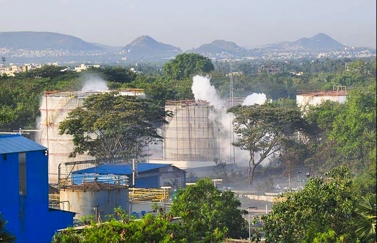Smokes rise from an LG Polymers plant following a gas leak incident in Visakhapatnam on May 7, 2020. - At least five people have been killed and 1,000 hospitalised after a gas leak at a chemicals plant on the east coast of India, authorities said on May 7, warning the death toll would climb. The gas leaked out of two 5,000-tonne tanks that had been unattended due to India's coronavirus lockdown in place since late March, according to a local police officer. PHOTO: AFP