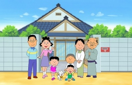 """This handout received on May 11, 2020 from the Hasagawa Michiko Art Museum in Tokyo shows an image from the """"Sazae-san"""" TV cartoon series, with the character Sazae-san (2nd L) and her family in front of their house. - Production of the world's longest-running cartoon """"Sazae-san"""" and a mainstay of the Japanese weekend has been interrupted by the COVID-19 coronavirus, forcing the broadcast by Fuji Television Network of re-runs for the first time in decades. (Photo by Handout / HASEGAWA MICHIKO ART MUSEUM / AFP) / -----EDITORS NOTE --- RESTRICTED TO EDITORIAL USE - MANDATORY CREDIT """"AFP PHOTO / HASEGAWA MICHIKO ART MUSEUM"""" - NO MARKETING - NO ADVERTISING CAMPAIGNS - DISTRIBUTED AS A SERVICE TO CLIENTS  - NO ARCHIVES MANDATORY MENTION OF THE ARTIST UPON PUBLICATION - TO ILLUSTRATE THE EVENT AS SPECIFIED IN THE CAPTION /"""