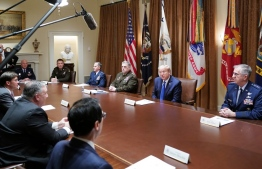 US President Donald Trump flanked by Chairman of the Joint Chiefs of Staff General Mark Milley (3rd R) and Vice Chairman of the Joint Chiefs of Staff General John Hyten (R) meets with military leaders and national security team in the Cabinet Room of the White House in Washington, DC on May 9, 2020. - Front from left: National Security Advisor to the vice president, Keith Kellogg, Defense Secretary Mark Esper, Secretary of State Mike Pompeo, and Treasury Secretary Steven Mnuchin. (Photo by MANDEL NGAN / AFP)