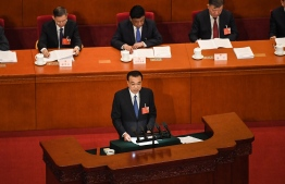 "Chinese Premier Li Keqiang delivers his speech during the opening session of the National People's Congress (NPC) at the Great Hall of the People in Beijing on May 22, 2020. - China faces ""immense"" economic challenges as it emerges from the coronavirus pandemic, Premier Li Keqiang warned on May 22 as he opened his nation's annual legislative session that will seek to tighten Beijing's control over Hong Kong. PHOTO: LEO RAMIREZ / AFP"