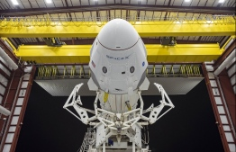 In this image released by Space X, the Crew Dragon spacecraft and the SpaceX Falcon 9 rocket are pictured at Launch Complex 39A on May 21, 2020, as preparations continue for the Demo-2 mission at NASA's Kennedy Space Center in Florida. - The Crew Dragon will take off from Kennedy on May 27 with help from SpaceX's Falcon 9 rocket and dock at the ISS. (Photo by - / SPACEX / AFP) /
