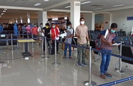 Bangladeshi nationals at VIA, ready to board their repatriation flight. PHOTO/MALDIVIAN