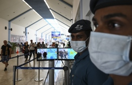 Sri Lankan Airport Officials, wearing facemasks, monitor screens of a thermal scanner to check body temperature of arriving passengers, at Bandaranaike International airport in Katunayake on January 24, 2020, following a virus outbreak in China. - The SARS-like virus has killed at least 26 in China, as concerns mount about a wider outbreak. PHOTO: LAKRUWAN WANNIARACHCHI / AFP