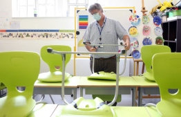 Head teacher Denis Bittmann rearranges the classrooms to provide a teaching environment safe from the novel coronavirus COVID-19 for pupils and teachers at Collège Français Bilingue de Londres at Kentish Town, north London on May 27, 2020, ahead of the Government's proposed recommencing of education for Reception and Year 1 classes.  Isabel Infantes / AFP