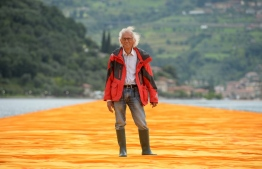 "(FILES) In this file photo taken on June 16, 2016, artist Christo Vladimirov Javacheff poses on his monumental installation ""The Floating Piers"" he created with late Jeanne-Claude during a press preview at the lake Iseo, northern Italy. - The artist known as Christo, who made his name transforming landmarks by covering them with reams of cloth, died on May 31, 2020, aged 84, his official Facebook page announced. Christo Vladimirov Javacheff died of natural causes at his home in New York City, the statement said. (Photo by Filippo MONTEFORTE / AFP) /"