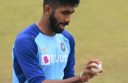 "(FILES) In this file photo taken on March 11, 2020 Indian cricketer Jasprit Bumrah preapres to bowl during a practice session ahead of tomorrow's first one day international (ODI) cricket match of a three match series between India and South Africa, at the Himachal Pradesh Cricket Association Stadium in Dharamsala. - Indian paceman Jasprit Bumrah said cricket should seek an ""alternative"" for shining the ball if the game's governing body ban the use of saliva during the coronavirus pandemic. The International Cricket Council (ICC) is likely to implement a ban for the game's return when they meet next week after receiving medical advice that spit poses a COVID-19 transmission risk. (Photo by SAJJAD HUSSAIN / AFP) /"