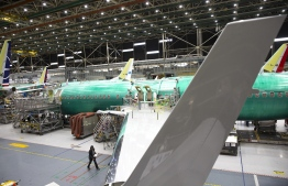 (FILES) In this file photo taken on March 27, 2019, employees work on Boeing 737 MAX airplanes at the Boeing Renton Factory in Renton, Washington. - US manufacturers are seeing the first hints of a tentative recovery but conditions for the industry were nonetheless terrible in May, according to an industry survey released June 1, 2020. The Institute for Supply Management's (ISM) monthly manufacturing survey was worse than expected and showed the continuing headwinds facing a key sector in the world's largest economy even as major firms restart production. And with social distancing protocols being enforced at major manufacturers who have restarted production like Boeing and the Detroit automakers, Fiore warned that the recovery may only bring manufacturing back to levels below what they were before the pandemic. (Photo by Jason Redmond / AFP)