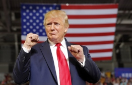 In this July 17, 2019, photo, President Donald Trump arrives to speak at a campaign rally at Williams Arena in Greenville, N.C. (AP Photo/Carolyn Kaster)