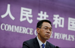 FILE PHOTO: China's Ministry of Commerce spokesperson Gao Feng attends a news conference at the commerce ministry in Beijing, China, June 19, 2018. REUTERS/Thomas Peter/File Photo