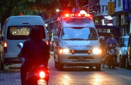 An ambulance drives down a street in Male' City. FILE PHOTO: NISHAN ALI / MIHAARU