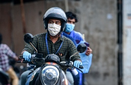 Motorcyclist pictured driving in capital city Male'. PHOTO: NISHAN ALI / MIHAARU