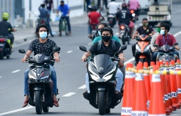 Motorists seen on the Sinamale' Bridge in the capital city Male'. HPA has tightens restrictions on Male' City again amid a surge in virus cases. PHOTO: NISHAN ALI / MIHAARU