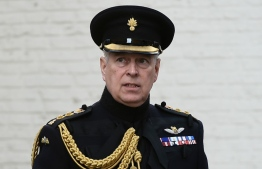 """(FILES) In this file photo taken on September 07, 2019 Britain's Prince Andrew, Duke of York, attends a ceremony commemorating the 75th anniversary of the liberation of Bruges, in Bruges. - Queen Elizabeth II's second son, Prince Andrew, on June 8, 2020, denied failing to cooperate with the US Department of Justice (DoJ) in its investigation into the late sex offender Jeffrey Epstein. Claims he had offered """"zero cooperation"""" in the case were untrue, his lawyers said, adding: """"The Duke of York has on at least three occasions this year offered his assistance as a witness to the DoJ."""" (Photo by JOHN THYS / AFP)"""