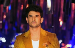 """(FILES) In this file photo taken on August 20, 2017 Indian Bollywood actor Sushant Singh Rajput poses for a photograph during the grand finale of Lakme Fashion Week (LFW) Winter/Festive 2017 in Mumbai. - A young Bollywood heartthrob lauded for his portrayal of cricket star M.S. Dhoni on the silver screen has taken his own life, Mumbai police said on June 14, the latest in a string of deaths to rock India's entertainment industry. """"Police found Sushant Singh Rajput's body at his residence Sunday afternoon,"""" Mumbai police spokesman Pranay Ashok told AFP, confirming that the 34-year-old had taken his own life. Rajput, renowned for his numerous hits on the big and small screens, reportedly battled depression. (Photo by Sujit Jaiswal / AFP)"""