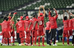 Bayern's players celebrate after the German first division Bundesliga football match SV Werder Bremen v FC Bayern Munich on June 16, 2020 in Bremen, northern Germany. - Bayern Munich were crowned German Bundesliga champions for the eight year in a row on June 16, 2020 after their away win against Bremen. (Photo by Martin MEISSNER / POOL / AFP) / DFL REGULATIONS PROHIBIT ANY USE OF PHOTOGRAPHS AS IMAGE SEQUENCES AND/OR QUASI-VIDEO
