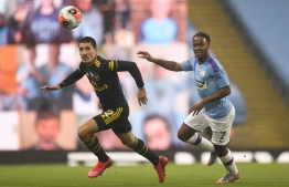 Arsenal's Spanish defender Hector Bellerin (L) vies for the ball against Manchester City's English midfielder Raheem Sterling (R) during the English Premier League football match between Manchester City and Arsenal at the Etihad Stadium in Manchester, north west England, on June 17, 2020. - The Premier League makes its eagerly anticipated return today after 100 days in lockdown but behind closed doors due to coronavirus restrictions. PHOTO: PETER POWELL / POOL / AFP