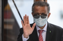 World Health Organization (WHO) Director-General Tedros Adhanom Ghebreyesus wears a protective fave mask after leaving a ceremony in Geneva. (Photo by Fabrice COFFRINI / AFP)