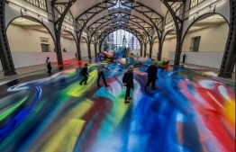"""Visitors take in German artist Katharina Grosse's installation """"It Wasn't Us"""" at Berlin's Hamburger Bahnhof museum for contemporary art on June 19, 2020. - The exhibition runs till January 10, 2021. (Photo by John MACDOUGALL / AFP) /"""