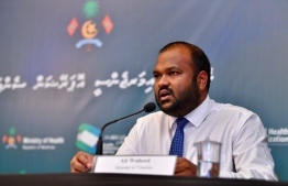 Minister of Tourism Ali Waheed addresses the press at one the regularly-held briefings hosted by National Emergency Operations Centre, on June 24. PHOTO: NEOC