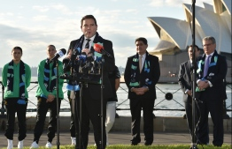 Football Federation Australia CEO James Johnson speaks to the media alongside Australian and New Zealand footballers and other officials in Sydney on June 26, 2020, after Australia and New Zealand won hosting rights for the 2023 Women's World Cup. - Football lovers in Australia and New Zealand offered rare praise for FIFA's transparency after the southern hemisphere neighbours were chosen to host the 2023 women's World Cup. (Photo by PETER PARKS / AFP) /