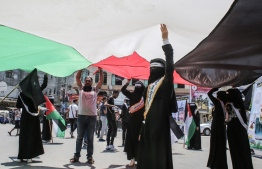 Palestinians rally against Israel's West Bank annexation plans, in Rafah in the southern Gaza Strip on June 29, 2020. (Photo by SAID KHATIB / AFP)