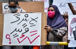 "Woman holding up a sign that reads ""who will take responsibility"" in demonstrations held by protestors over the lack of justice for victims of rape and sexual abuse. PHOTO: NISHAN ALI/ MIHAARU"