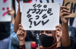 """A protestor holding up a sign that reads """"who will take responsibility?"""" in a demonstration held on the streets of Male' City, against all forms of sexual violence and to hold perpetrators and the authorities accountable, on June 29, 2020. PHOTO: NISHAN ALI / MIHAARU"""