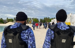 Police officers during the operation on B. Bodufinolhu to deescalate the situation after expatriate workers held local staff captive, protesting over six months of unpaid salaries. PHOTO/POLICE